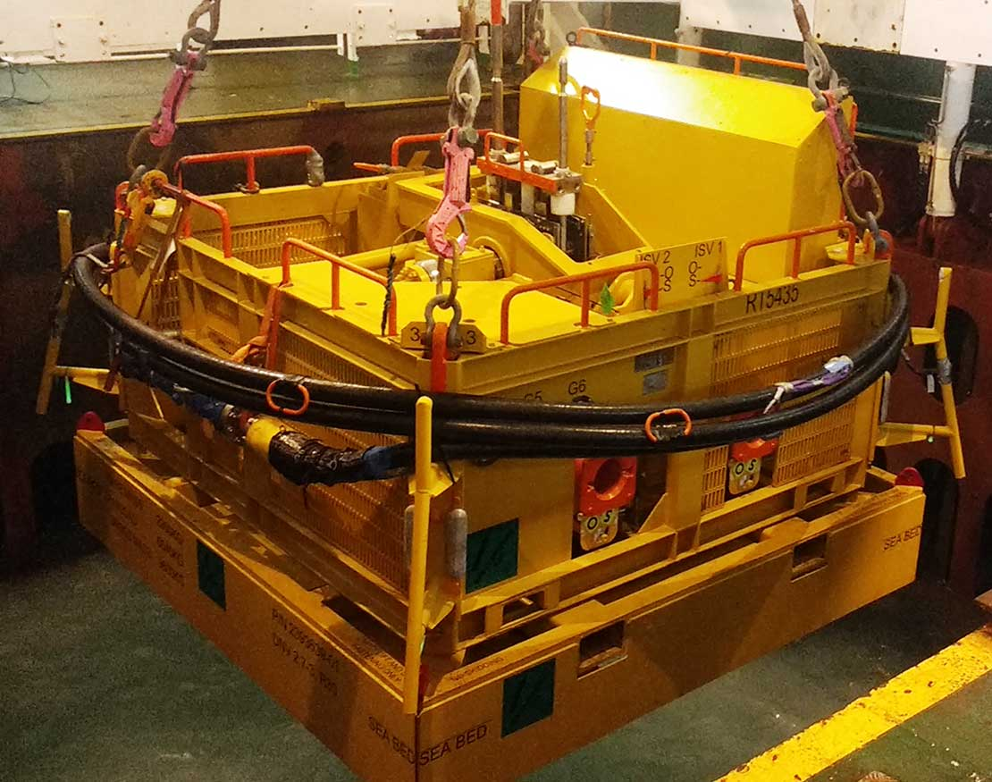 Photo of a subsea safety module with an integral mudmat being deployed on wire.