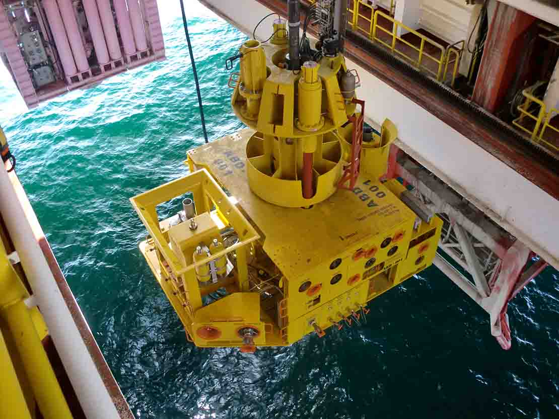 Standard configurable subsea tree lowered into water.