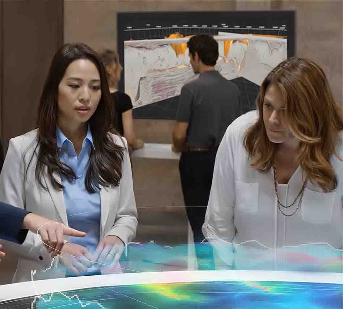 Two women around holographic subsea field