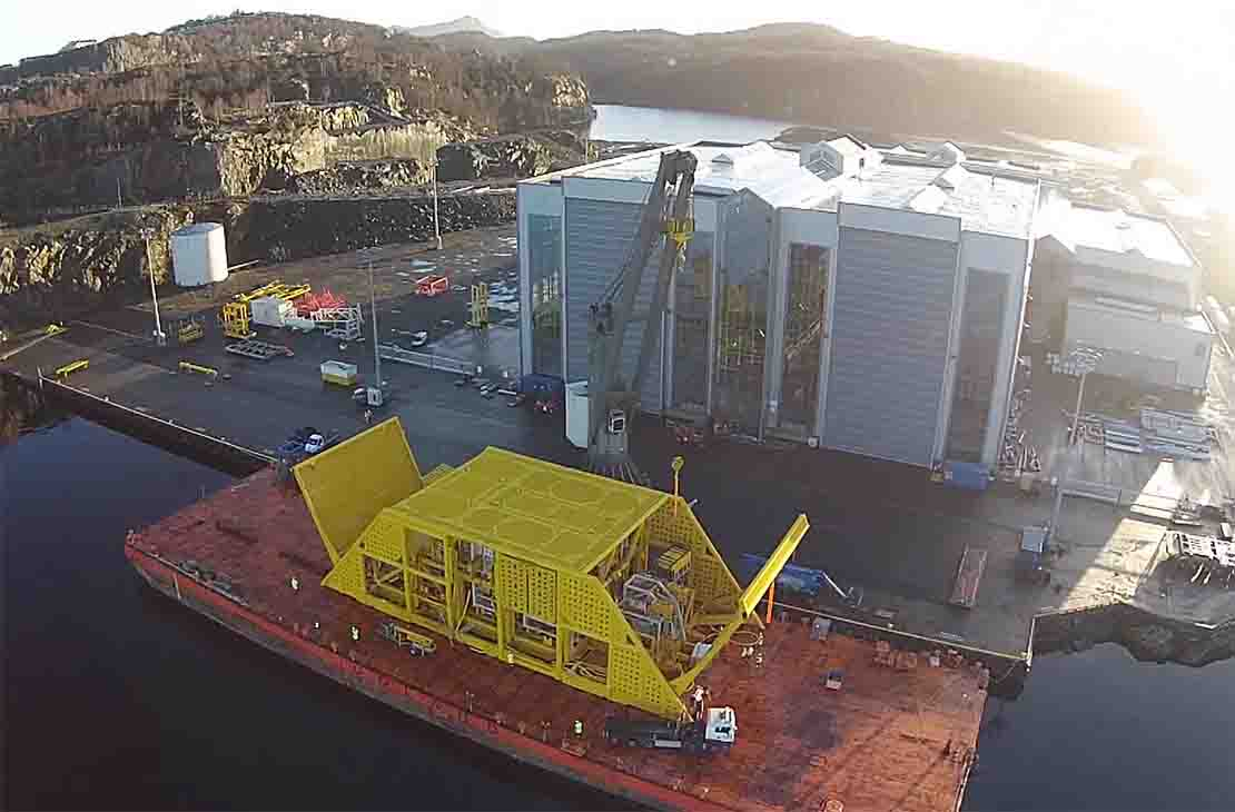 Multiphase WGC compressor being loaded out for shipment offshore.