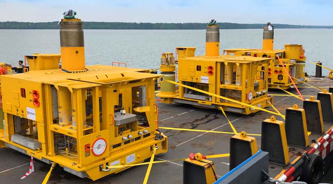Three horizontal subsea trees are prepared for loadout in the GOM.