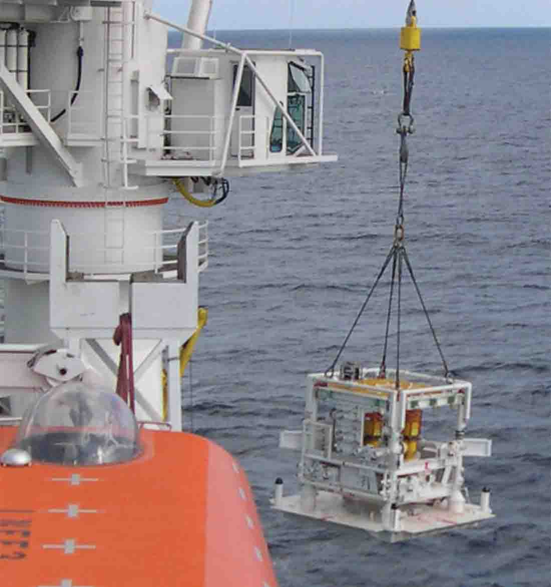 Offshore manifold being lowered into the water.